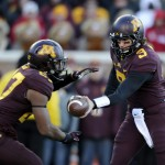MINNEAPOLIS, MN - NOVEMBER 23: Philip Nelson #9 of the Minnesota Golden Gophers hands the ball to David Cobb #27 of the Minnesota Golden Gophers during the first quarter of the game against the Wisconsin Badgers on November 23, 2013 at TCF Bank Stadium in Minneapolis, Minnesota. (Photo by Hannah Foslien/Getty Images)