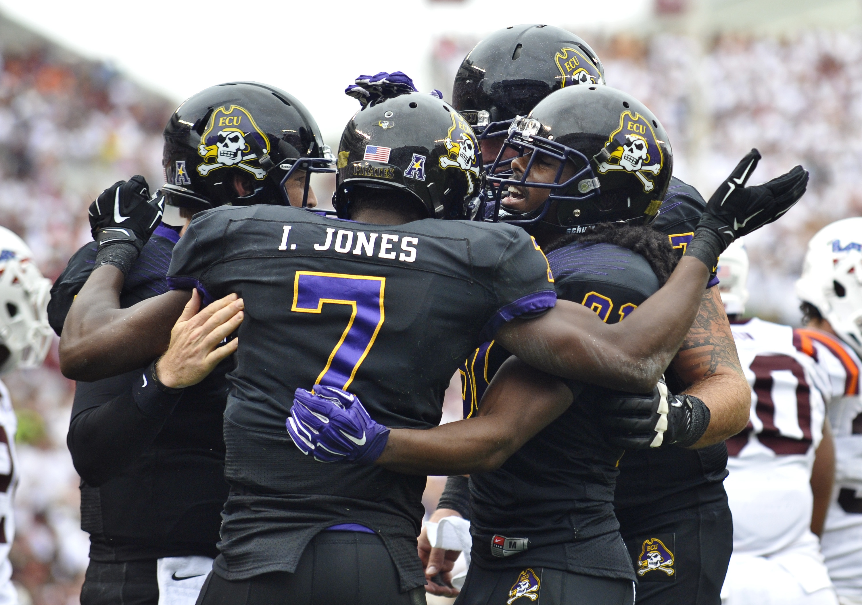 BLACKSBURG, VA - SEPTEMBER 13:  Wide receiver Isaiah Jones #7 of the East Carolina Pirates is surrounded by teammates as he celebrates his touchdown in the first half at Lane Stadium on September 13, 2014 in Blacksburg, Virginia. East Carolina leads Virginia Tech 21-7 at halftime.  (Photo by Michael Shroyer/Getty Images)
