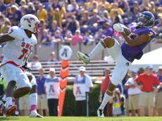 GREENVILLE, NC - OCTOBER 04:  Travon Simmons #3 of the East Carolina Pirates intercepts a pass intended for Der'rikk Thompson #7 of the Southern Methodist Mustangs during their game at Dowdy-Ficklen Stadium on October 4, 2014 in Greenville, North Carolina. East Carolina won 45-24. (Photo by Grant Halverson/Getty Images)