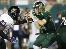 TAMPA, FL - OCTOBER 11:  Mike White #14 of the South Florida Bulls gets sacked by Fred Presley #99 of the East Carolina Pirates in the first half of the game at Raymond James Stadium on October 11, 2014 in Tampa, Florida. (Photo by Joe Robbins/Getty Images)