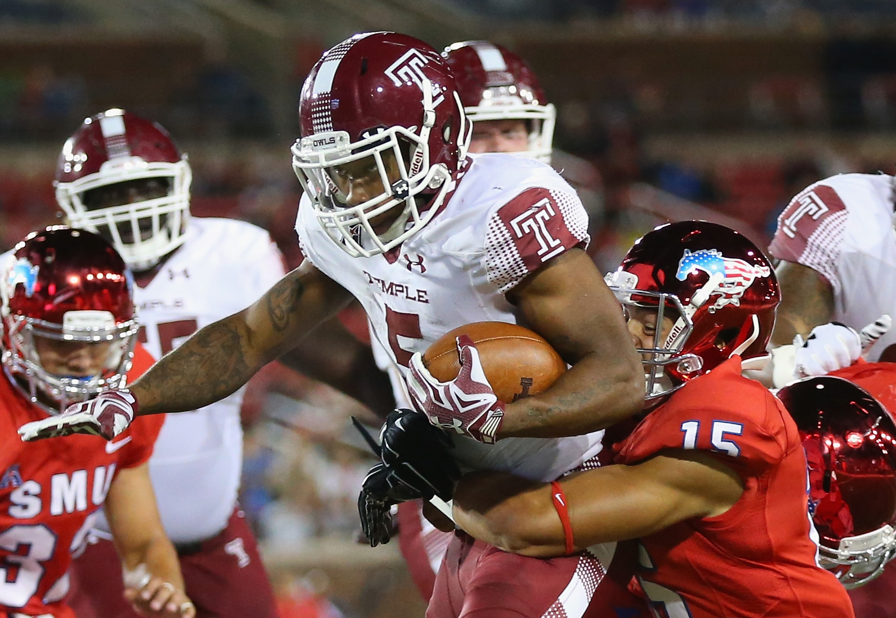 DALLAS, TX - NOVEMBER 06:  Jahad Thomas #5 of the Temple Owls runs the ball against Jordan Wyatt #15 of the Southern Methodist Mustangs in the second half at Gerald J. Ford Stadium on November 6, 2015 in Dallas, Texas.  (Photo by Ronald Martinez/Getty Images)