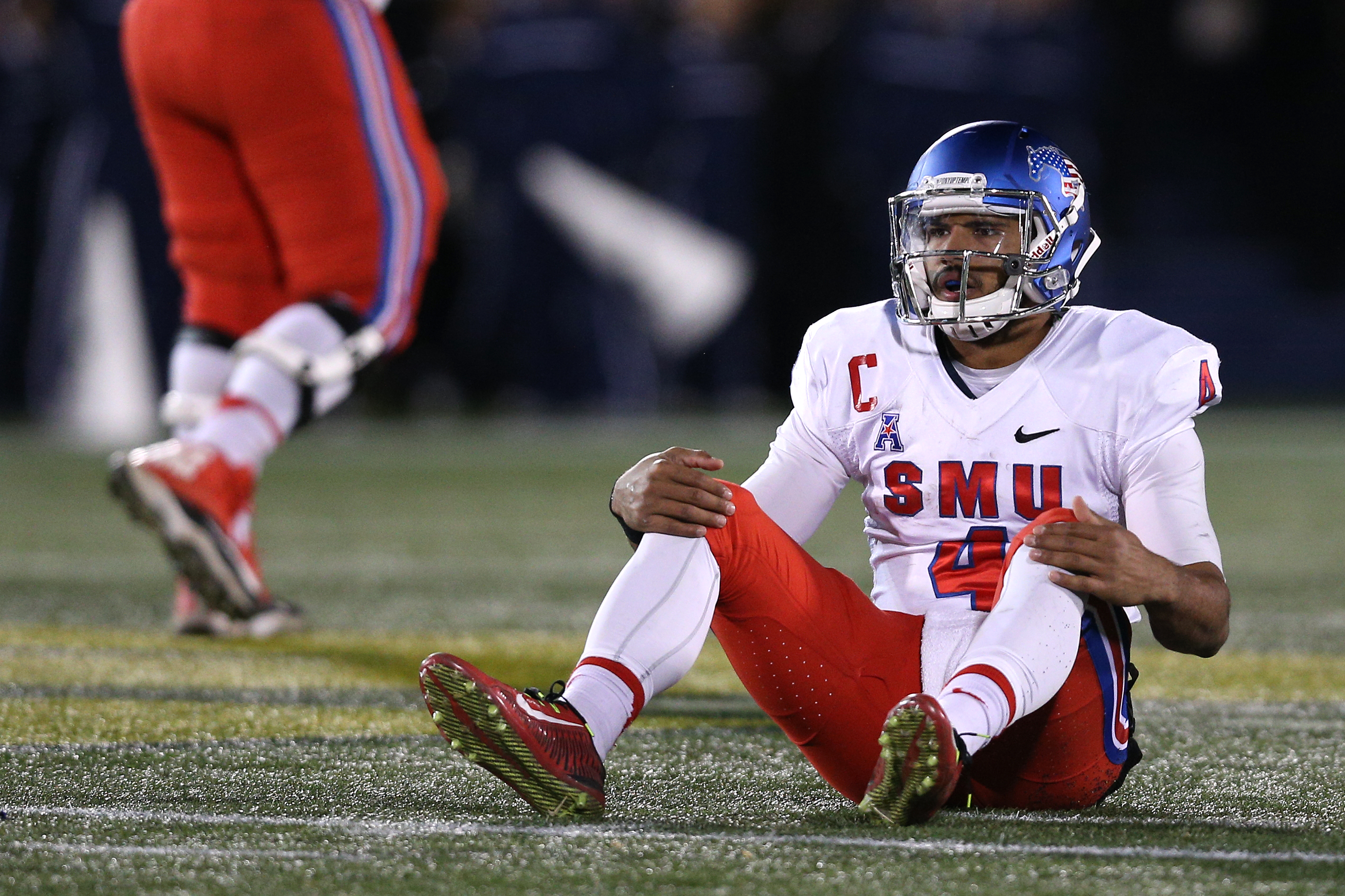 ANNAPOLIS, MD - NOVEMBER 14: Quarterback Matt Davis #4 of the Southern Methodist Mustangs looks on after a failed fourth down conversion in the third quarter against the Navy Midshipmen during the first half at Navy-Marine Corps Memorial Stadium on November 14, 2015 in Annapolis, Maryland. The Navy Midshipmen won, 55-14. (Photo by Patrick Smith/Getty Images)