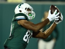 NEW ORLEANS, LA - NOVEMBER 27:  Andrew Hicks #80 of the Tulane Green Wave catches a pass for a touchdown during the second half of a game against the Tulsa Golden Hurricane at Yulman Stadium on November 27, 2015 in New Orleans, Louisiana.  (Photo by Stacy Revere/Getty Images)