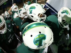 NEW ORLEANS, LA - SEPTEMBER 03:  Members of the Tulane Green Wave are introduced before playing the Duke Blue Devils on September 3, 2015 in New Orleans, Louisiana.  (Photo by Chris Graythen/Getty Images)