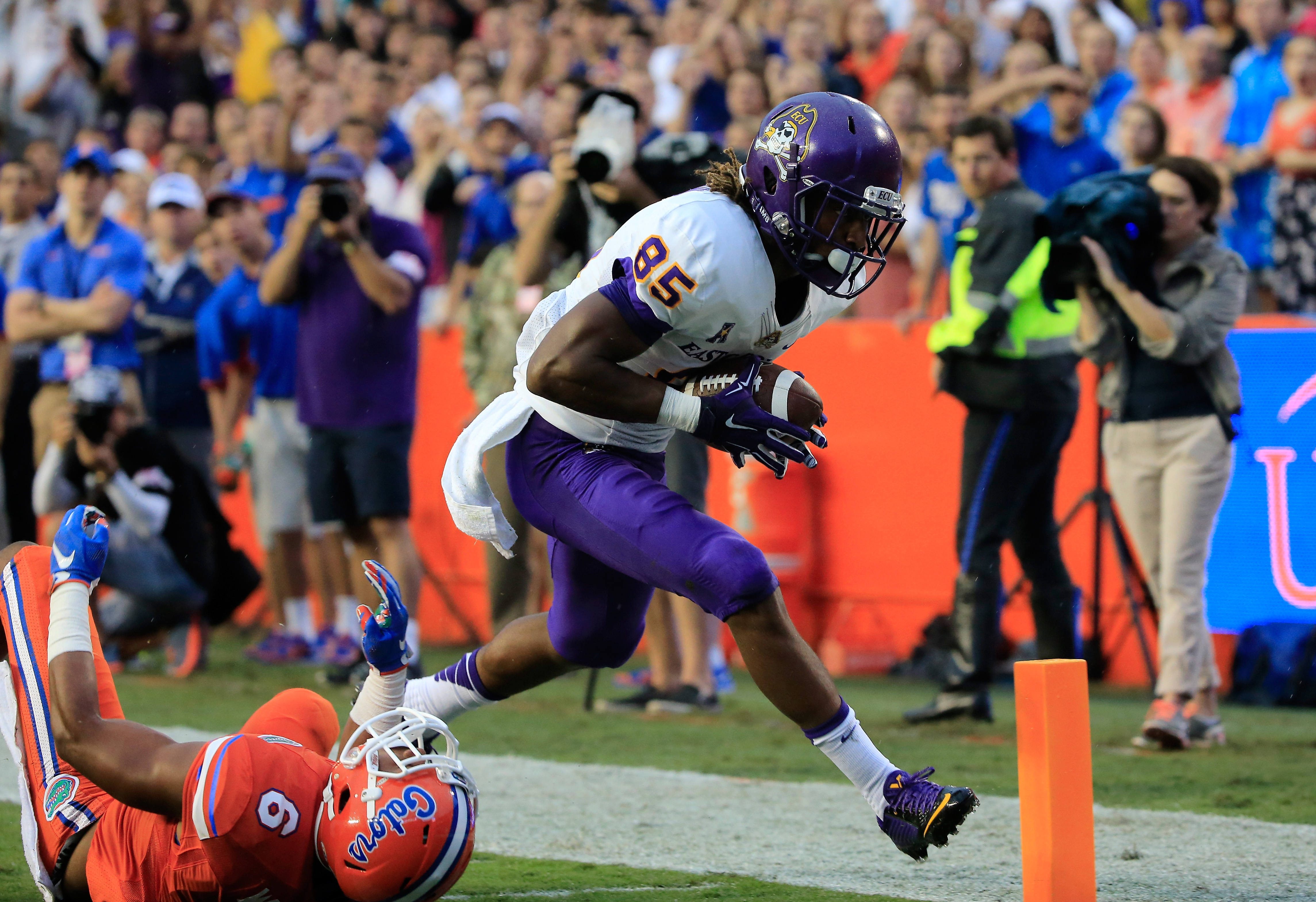 GAINESVILLE, FL - SEPTEMBER 12:  Davon Grayson #85 of the East Carolina Pirates crosses the goal line for a touchdown against Quincy Wilson #6 of the Florida Gators during the game at Ben Hill Griffin Stadium on September 12, 2015 in Gainesville, Florida.  (Photo by Sam Greenwood/Getty Images)