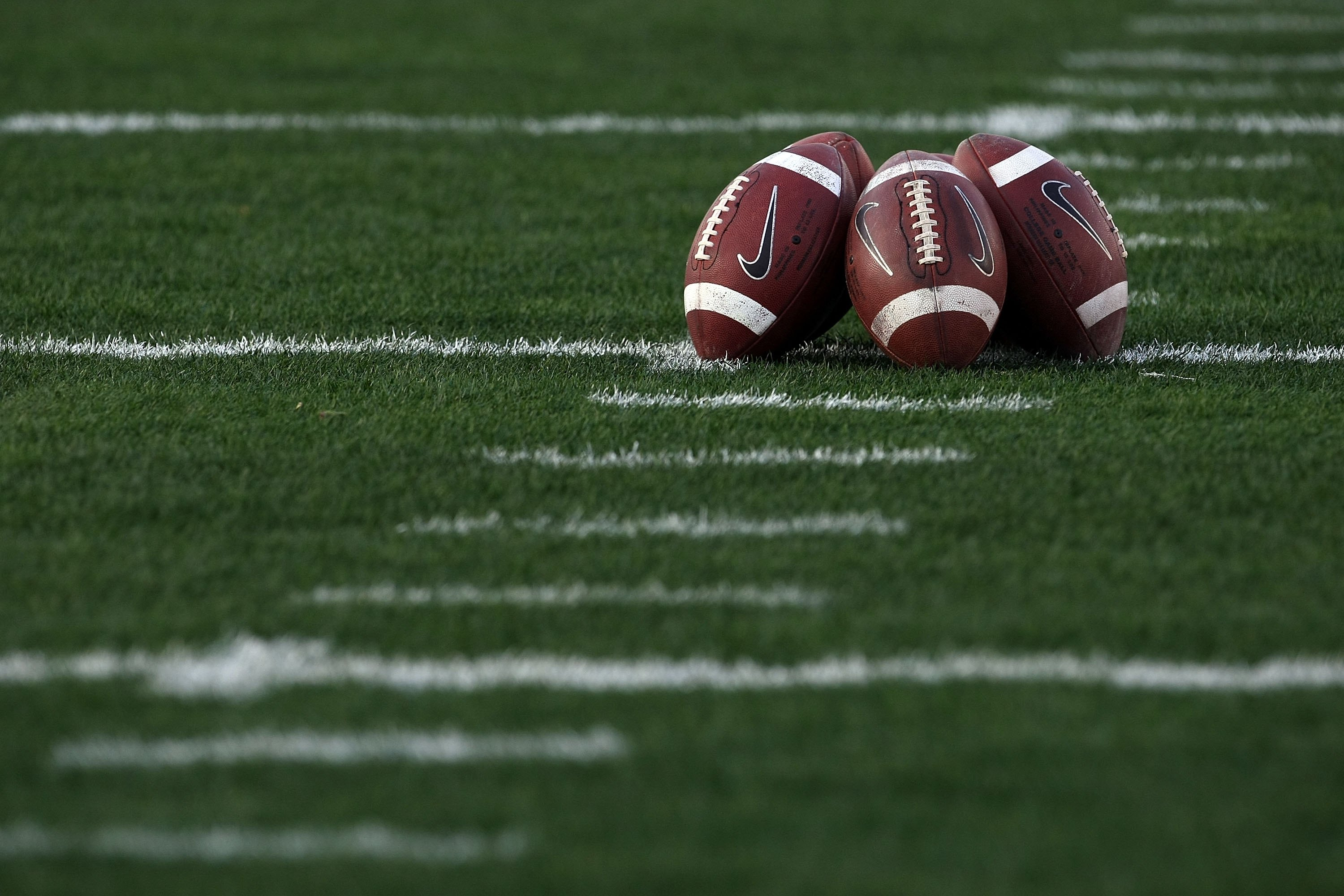 PASADENA, CA - JANUARY 07:  A detailed picture of footballs on the field prior to the Citi BCS National Championship game between the Texas Longhorns and the Alabama Crimson Tide at the Rose Bowl on January 7, 2010 in Pasadena, California.  (Photo by Stephen Dunn/Getty Images)
