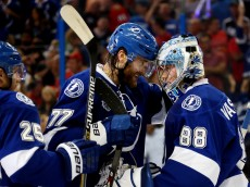 TAMPA, FL - JUNE 06:  Victor Hedman #77 of the Tampa Bay Lightning celebrates with teammate Andrei Vasilevskiy #88 after defeating the Chicago Blackhawks 4 to 3 in Game Two of the 2015 NHL Stanley Cup Final at Amalie Arena on June 6, 2015 in Tampa, Florida.  (Photo by Bruce Bennett/Getty Images)
