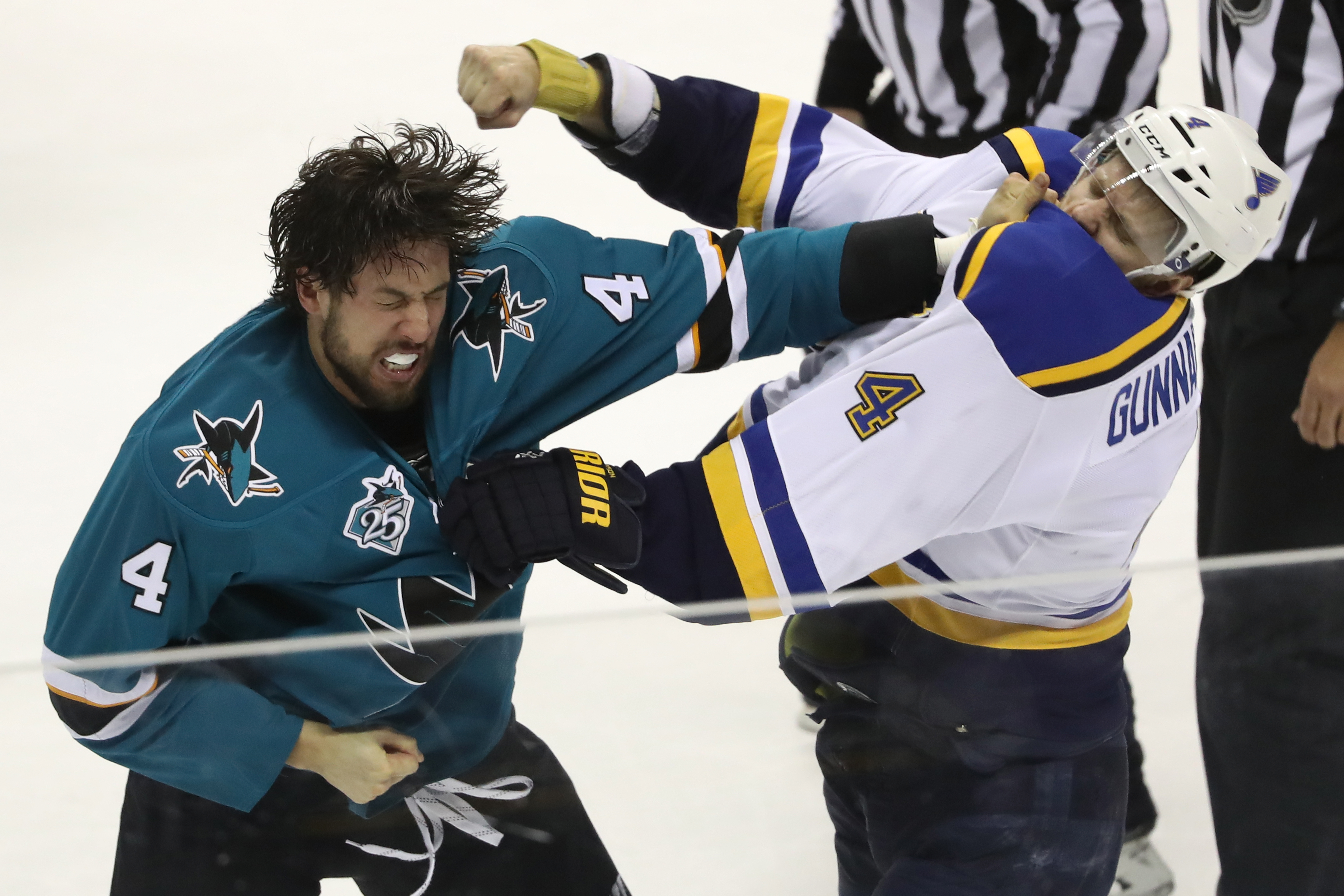 SAN JOSE, CA - MAY 21:  Brenden Dillon #4 of the San Jose Sharks fights with Carl Gunnarsson #4 of the St. Louis Blues in game four of the Western Conference Finals during the 2016 NHL Stanley Cup Playoffs at SAP Center on May 21, 2016 in San Jose, California.  (Photo by Sean M. Haffey/Getty Images)