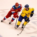 TORONTO, ON - SEPTEMBER 18: Anton Stralman #6 of Team Sweden looks to pass around Artemi Panarin #27 of Team Russia in the third period during the World Cup of Hockey at the Air Canada Center on September 18, 2016 in Toronto, Canada. Team Sweden won the game 2-1. (Photo by Gregory Shamus/Getty Images)