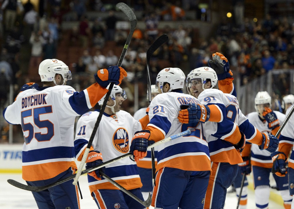 Nov 5, 2014; Anaheim, CA, USA; New York Islanders center John Tavares (91) celebrates with his team after scoring a goal to win the game during overtime against the Anaheim Ducks at Honda Center. The New York Islanders defeated the Anaheim Ducks in overtime with a final score of 3-2. Mandatory Credit: Kelvin Kuo-USA TODAY Sports