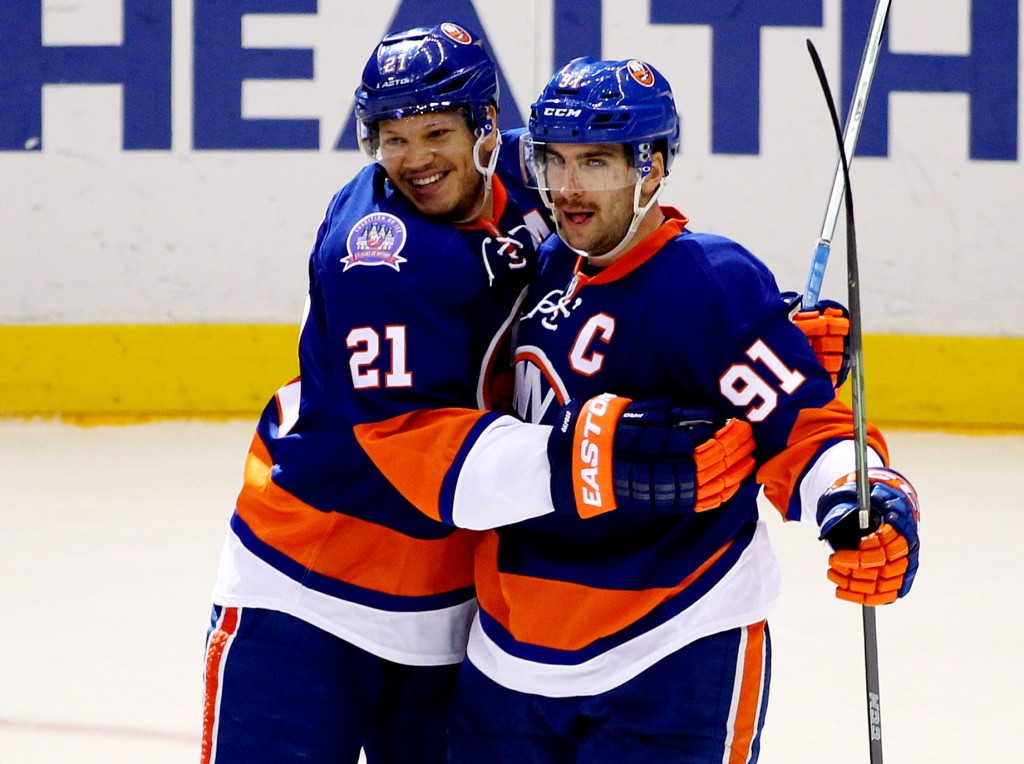 Nov 22, 2014; Uniondale, NY, USA; New York Islanders center John Tavares (91) celebrates with right wing Kyle Okposo (21) after scoring a goal against the Pittsburgh Penguins in the third period at Nassau Veterans Memorial Coliseum. The Islanders won 4-1. Mandatory Credit: Andy Marlin-USA TODAY Sports