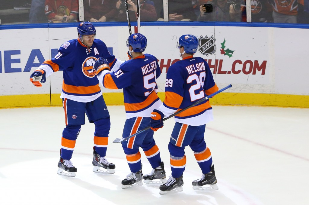 Dec 13, 2014; Uniondale, NY, USA;  New York Islanders right wing Kyle Okposo (21) celebrates his goal with teammates during the third period against the Chicago Blackhawks at Nassau Veterans Memorial Coliseum. New York Islanders won 3-2. Mandatory Credit: Anthony Gruppuso-USA TODAY Sports