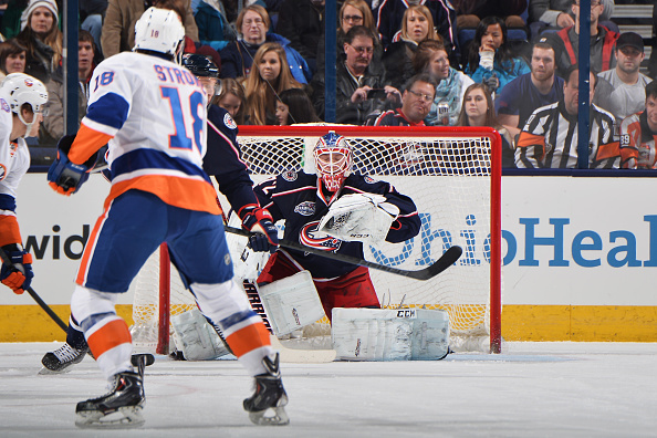 COLUMBUS, OH - JANUARY 10: Goaltender Sergei Bobrovsky #72 of the Columbus Blue Jackets makes a glove save on a shot taken by Ryan Strome #18 of the New York Islanders during the first period on January 10, 2015 at Nationwide Arena in Columbus, Ohio.  (Photo by Jamie Sabau/NHLI via Getty Images)
