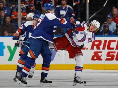 UNIONDALE, NY - JANUARY 27: Matt Martin #17 of the New York Islanders hits Carl Hagelin #62 of the New York Rangers during the first period at the Nassau Veterans Memorial Coliseum on January 27, 2015 in Uniondale, New York.  (Photo by Bruce Bennett/Getty Images)