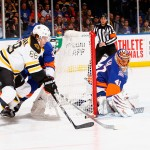 UNIONDALE, NY - JANUARY 29:  David Pastrnak #88 of the Boston Bruins attempts to score against Jaroslav Halak #41 of the New York Islanders s during their game at the Nassau Veterans Memorial Coliseum on January 29, 2015 in Uniondale, New York.  (Photo by Al Bello/Getty Images)