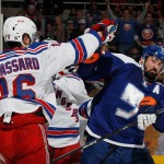 UNIONDALE, NY - JANUARY 27:  Derick Brassard #16 of the New York Rangers mixes it up with Cal Clutterbuck #15 of the New York Islanders following an interference call against Clutterbuck at the Nassau Veterans Memorial Coliseum on January 27, 2015 in Uniondale, New York.  (Photo by Bruce Bennett/Getty Images)