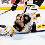 UNIONDALE, NY - JANUARY 29:  Tuukka Rask #40 of the Boston Bruins makes a save against the New York Islanders during their game at the Nassau Veterans Memorial Coliseum on January 29, 2015 in Uniondale, New York.  (Photo by Al Bello/Getty Images)