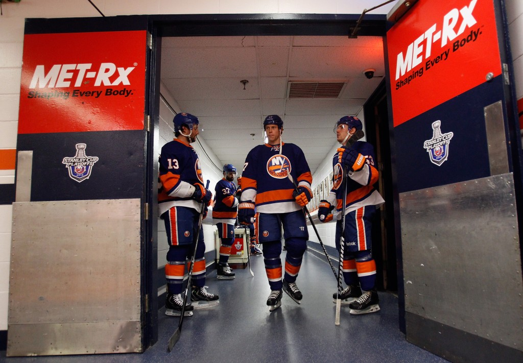 UNIONDALE, NY - MAY 07: (L-R) Colin McDonald #13, Matt Martin #17 and Casey Cizikas #53 of the New York Islanders walk out for warmups prior to the game against the Pittsburgh Penguins in Game Four of the Eastern Conference Quarterfinals during the 2013 NHL Stanley Cup Playoffs at the Nassau Veterans Memorial Coliseum on May 7, 2013 in Uniondale, New York.</p /> </p><!-- google_ad_section_end --></div>     <div class=