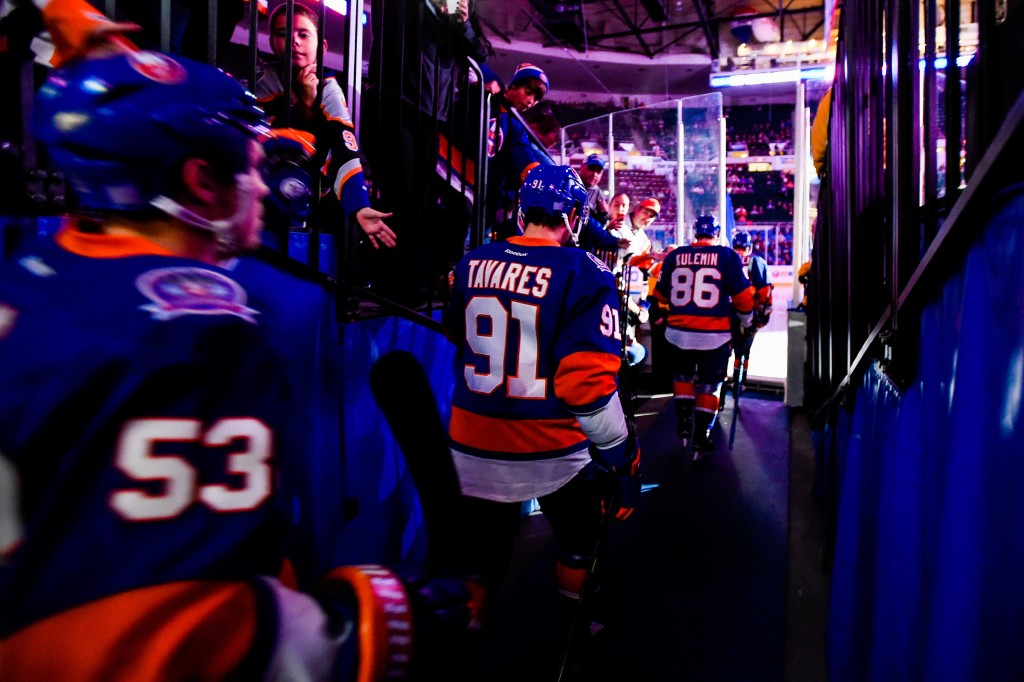 UNIONDALE, NY - OCTOBER 21:  John Tavares #91 of the New York Islanders takes the ice with his team before a game against the Toronto Maple Leafs at Nassau Veterans Memorial Coliseum on October 21, 2014 in Uniondale, New York.  (Photo by Alex Goodlett/Getty Images)