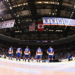 UNIONDALE, NY - JANUARY 29:  The New York Islanders stand before the National anthem against the Boston Bruins during their game at the Nassau Veterans Memorial Coliseum on January 29, 2015 in Uniondale, New York.  (Photo by Al Bello/Getty Images)