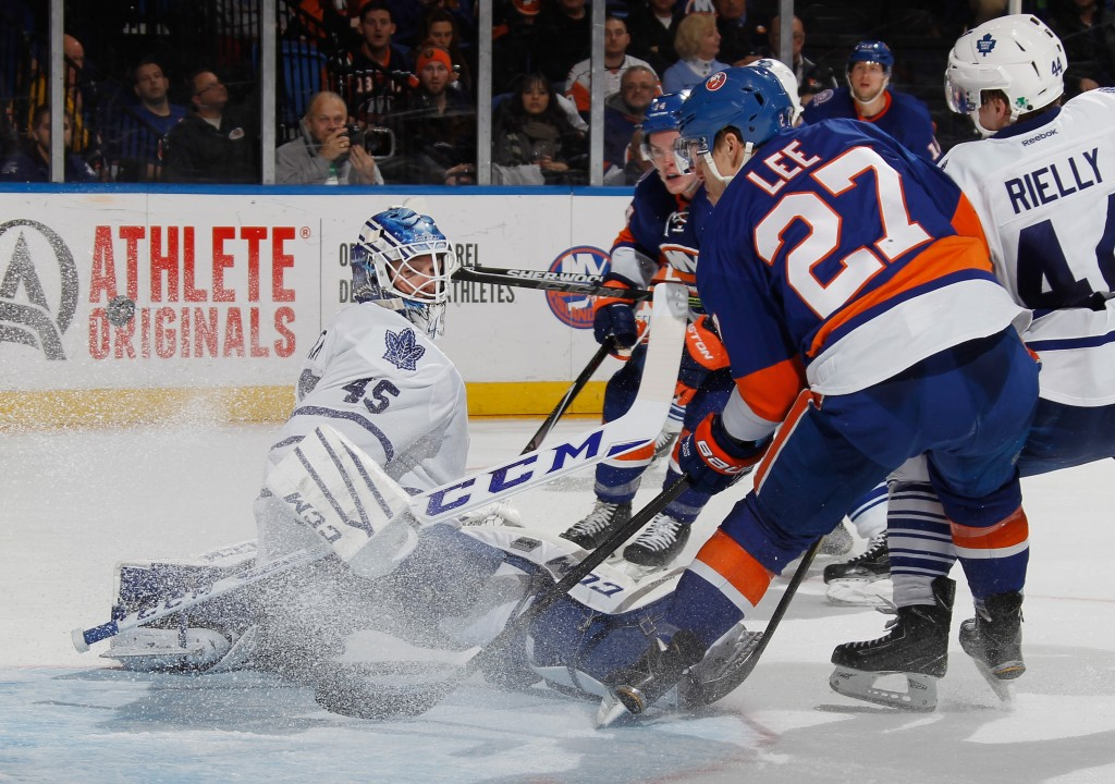 UNIONDALE, NY - FEBRUARY 12: Anders Lee #27 of the New York Islanders, who already had two goals in the game, gets the puck behind Jonathan Bernier #45 of the Toronto Maple Leafs but it doesn't go into the net during the second period at the Nassau Veterans Memorial Coliseum on February 12, 2015 in Uniondale, New York.  (Photo by Bruce Bennett/Getty Images)