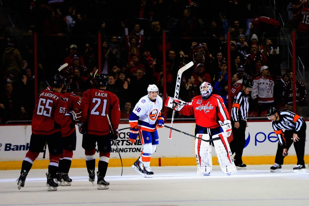 WASHINGTON, DC - FEBRUARY 21: Ryan Strome #18 of the New York Islanders skates off the ice as goalie Braden Holtby #70 of the Washington Capitals celebrates after the Capitals won 3-2 in a shootout at Verizon Center on February 21, 2015 in Washington, DC.  (Photo by Rob Carr/Getty Images)
