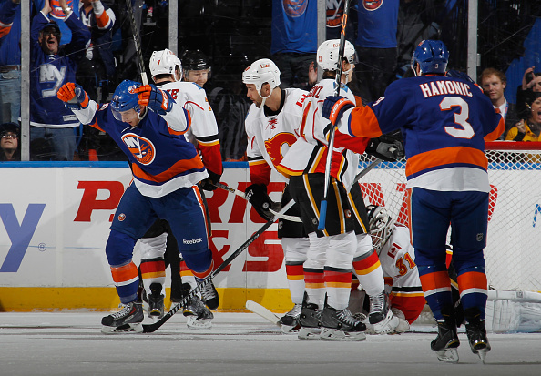 UNIONDALE, NY - FEBRUARY 27: Ryan  Strome #18 of the New York Islanders (l) celebrates his powerplay goal at 11:39 of the first period against the Calgary Flames at the Nassau Veterans Memorial Coliseum on February 27, 2015 in Uniondale, New York.  (Photo by Bruce Bennett/Getty Images)