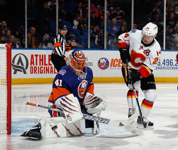UNIONDALE, NY - FEBRUARY 27: Jaroslav Halak #41 of the New York Islanders makes the third period save on Jiri Hudler #24 of the Calgary Flames at the Nassau Veterans Memorial Coliseum on February 27, 2015 in Uniondale, New York. The Islanders defeated the Flames 2-1. Halak set an Islander record for most wins in a season with 33. (Photo by Bruce Bennett/Getty Images)