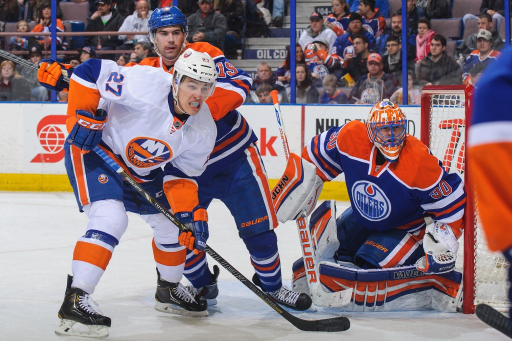 EDMONTON, AB - MARCH 06: Justin Schultz #19 and Ben Scrivens #30 of the Edmonton Oilers defend the net against Anders Lee #27 of the New York Islanders during an NHL game at Rexall Place on March 06, 2014 in Edmonton, Alberta, Canada. (Photo by Derek Leung/Getty Images)