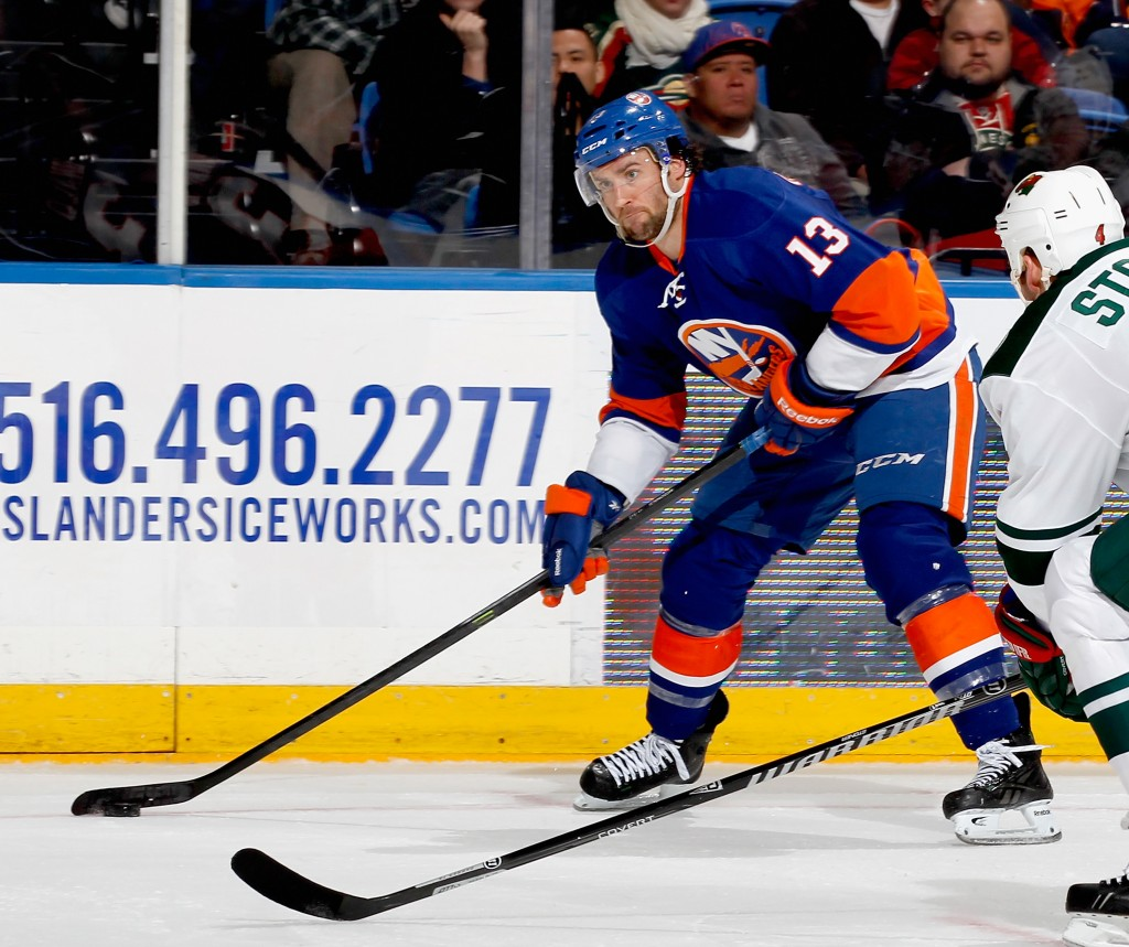 UNIONDALE, NY - MARCH 18:  Colin McDonald #13 of the New York Islanders skates during an NHL hockey game against the Minnesota Wild at Nassau Veterans Memorial Coliseum on March 18, 2014 in Uniondale, New York.  (Photo by Paul Bereswill/Getty Images)