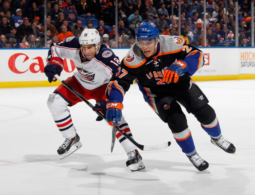 UNIONDALE, NY - MARCH 23: Anders Lee #27 of the New York Islanders skates against the Columbus Blue Jackets at the Nassau Veterans Memorial Coliseum on March 23, 2014 in Uniondale, New York. The Islanders shut out the Blue Jackets 2-0.  (Photo by Bruce Bennett/Getty Images)