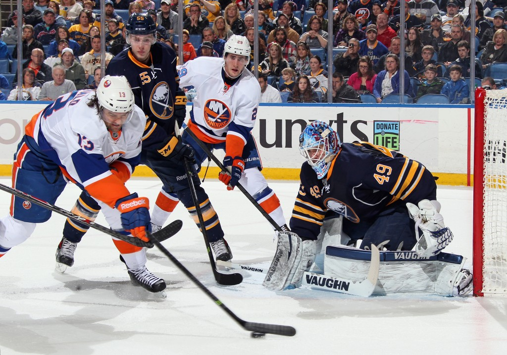 BUFFALO, NY - APRIL 13: Rasmus Ristolainen #55 and Connor Knapp #49 of the Buffalo Sabres defend the net against Brock Nelson #29 and Colin McDonald #13 of the New York Islanders at First Niagara Center on April 13, 2014 in Buffalo, New York.  (Photo by Jen Fuller/Getty Images)