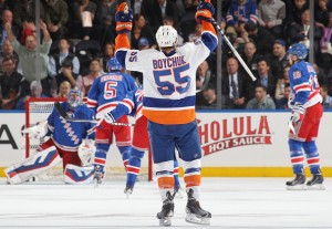NEW YORK, NY - OCTOBER 14:  Johnny Boychuk #55 of the New York Islanders celebrates after his first period goal against the New York Rangers at Madison Square Garden on October 14, 2014 in New York City. (Photo by Jared Silber/NHLI via Getty Images)