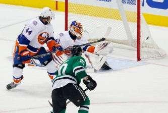 DALLAS, TX - MARCH 03:  Cody Eakin #20 of the Dallas Stars scores the game winning goal against Jaroslav Halak #41 of the New York Islanders ad Calvin de Haan #44 of the New York Islanders defends in overtime at American Airlines Center on March 3, 2015 in Dallas, Texas.  (Photo by Tom Pennington/Getty Images)