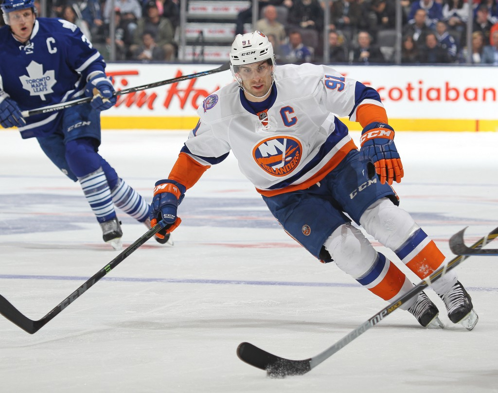 TORONTO, ON - MARCH 9:  John Tavares #91 of the New York Islanders skates after a puck against the Toronto Maple Leafs during an NHL game at the Air Canada Centre on March 9, 2015 in Toronto, Ontario, Canada. (Photo by Claus Andersen/Getty Images)