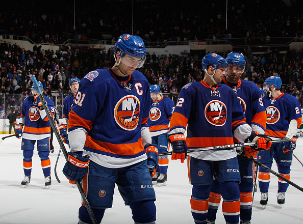 UNIONDALE, NY - MARCH 24: John Tavares #91 and the New York Islanders leave the ice following a 2-1 shoot out loss to the Minnesota Wild at the Nassau Veterans Memorial Coliseum on March 24, 2015 in Uniondale, New York. The Wild defeated the Islanders 2-1 in the shootout. (Photo by Bruce Bennett/Getty Images)