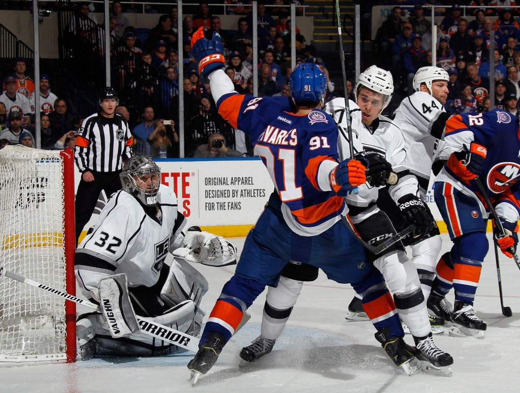 UNIONDALE, NY - MARCH 26: Nick Shore #37 of the Los Angeles Kings checks John Tavares #91 of the New York Islanders during the second period at the Nassau Veterans Memorial Coliseum on March 26, 2015 in Uniondale, New York.  (Photo by Bruce Bennett/Getty Images)