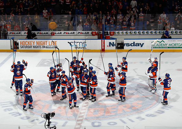 UNIONDALE, NY - MARCH 29:  The New York Islanders celebrate their 5-4 victory over the Detroit Red Wings at the Nassau Veterans Memorial Coliseum on March 29, 2015 in Uniondale, New York.  (Photo by Bruce Bennett/Getty Images)