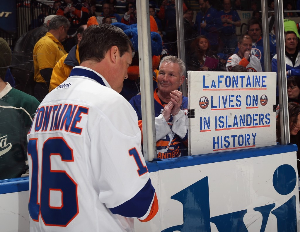 UNIONDALE, NY - MARCH 24:  Hall of Fame member Pat Lafontaine is honored prior to the game between the New York Islanders and the Minnesota Wild at the Nassau Veterans Memorial Coliseum on March 24, 2015 in Uniondale, New York.  (Photo by Bruce Bennett/Getty Images)