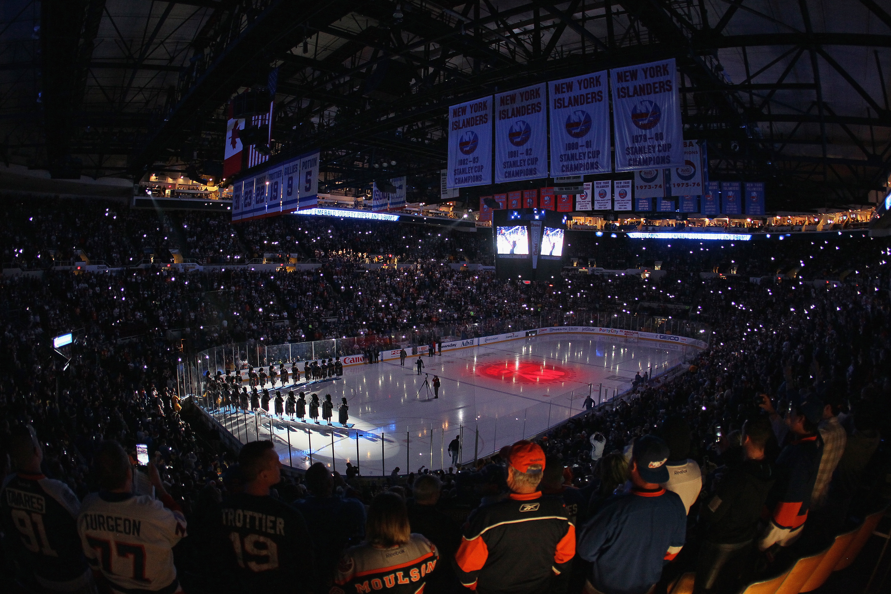 at the Nassau Veterans Memorial Coliseum on April 11, 2015 in Uniondale, New York. This is the last regular season game to be played in the building as it stands now. The team will relocate to the Barclay's Center in the Brooklyn borough of New York City starting in the 2015-16 season.