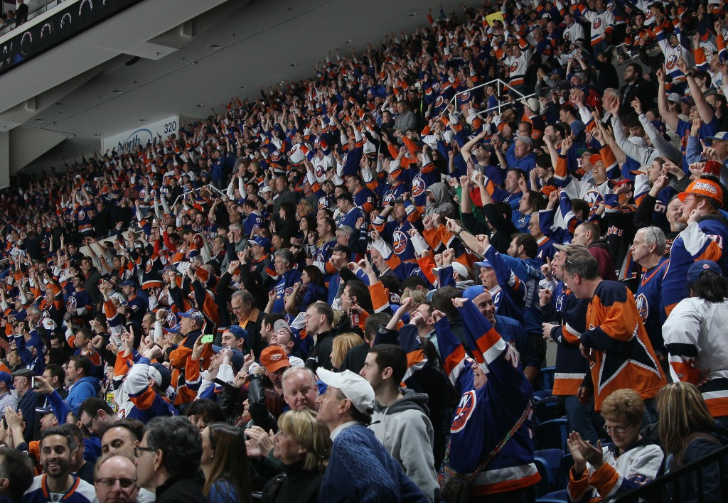 UNIONDALE, NY - APRIL 11:  The New York Islanders fans chant their signature