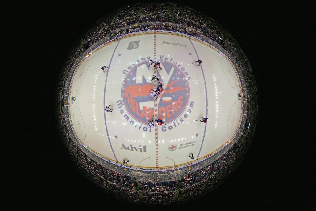 UNIONDALE, NY - APRIL 11: The New York Islanders and the Columbus Blue Jackets take the opening faceoff in their game at the Nassau Veterans Memorial Coliseum on April 11, 2015 in Uniondale, New York. This is the last regular season game to be played in the building as it stands now. The team will relocate to the Barclay's Center in the Brooklyn borough of New York City starting in the 2015-16 season.  (Photo by Bruce Bennett/Getty Images)