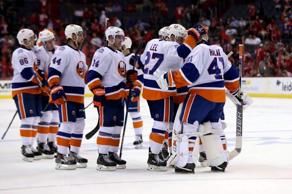 WASHINGTON, DC - APRIL 15: Goalie Jaroslav Halak #41 of the New York Islanders celebrates with teammates after the Islanders defeated the Washington CapitalMarcin Gortat #4 of the Washington Wizards-1 in Game One of the Eastern Conference Quarterfinals during the 2015 NHL Stanley Cup Playoffs at Verizon Center on April 15, 2015 in Washington, DC.  (Photo by Rob Carr/Getty Images)