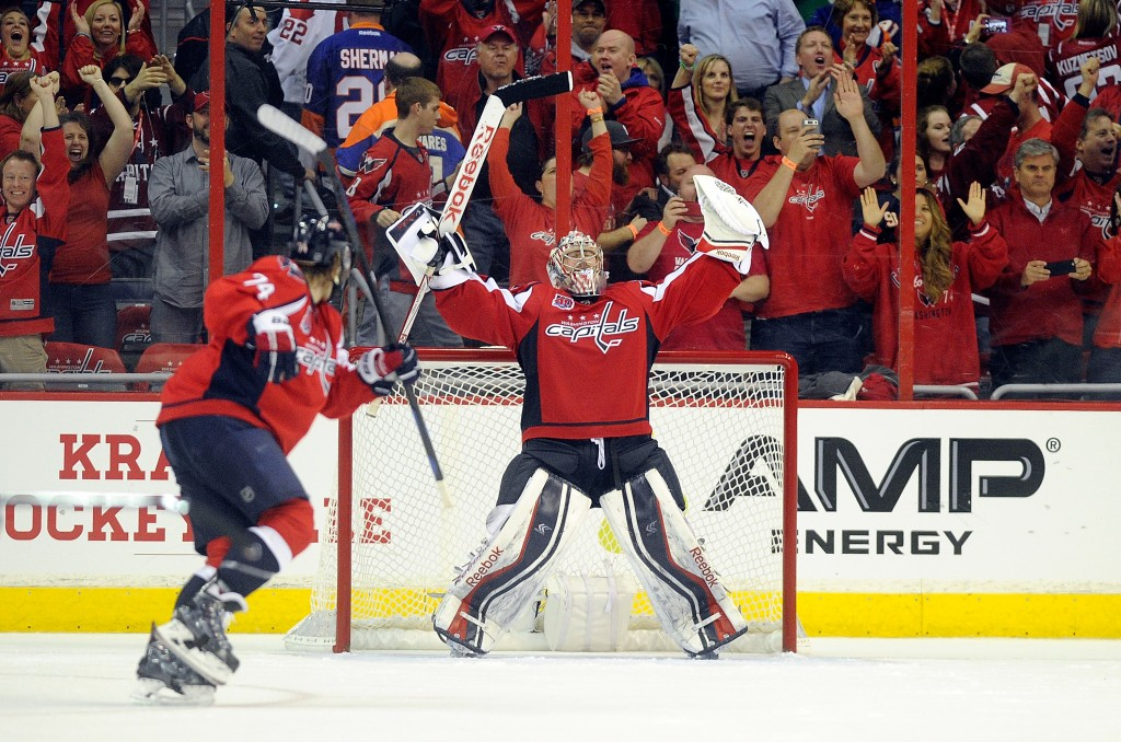 WASHINGTON, DC - APRIL 17: Philipp Grubauer #31 of the Washington Capitals celebrates after a 4-3 victory against the New York Islanders during Game Two of the Eastern Conference Quarterfinals during the 2015 NHL Stanley Cup Playoffs at Verizon Center on April 17, 2015 in Washington, DC. (Photo by Greg Fiume/Getty Images)