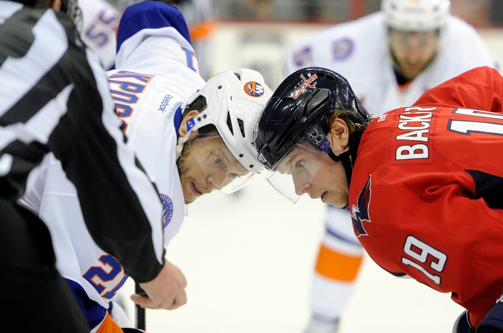 WASHINGTON, DC - APRIL 17:  Kyle Okposo #21 of the New York Islanders takes a face off in the first period against Nicklas Backstrom #19 of the Washington Capitals during Game Two of the Eastern Conference Quarterfinals during the 2015 NHL Stanley Cup Playoffs at Verizon Center on April 17, 2015 in Washington, DC.  (Photo by Greg Fiume/Getty Images)