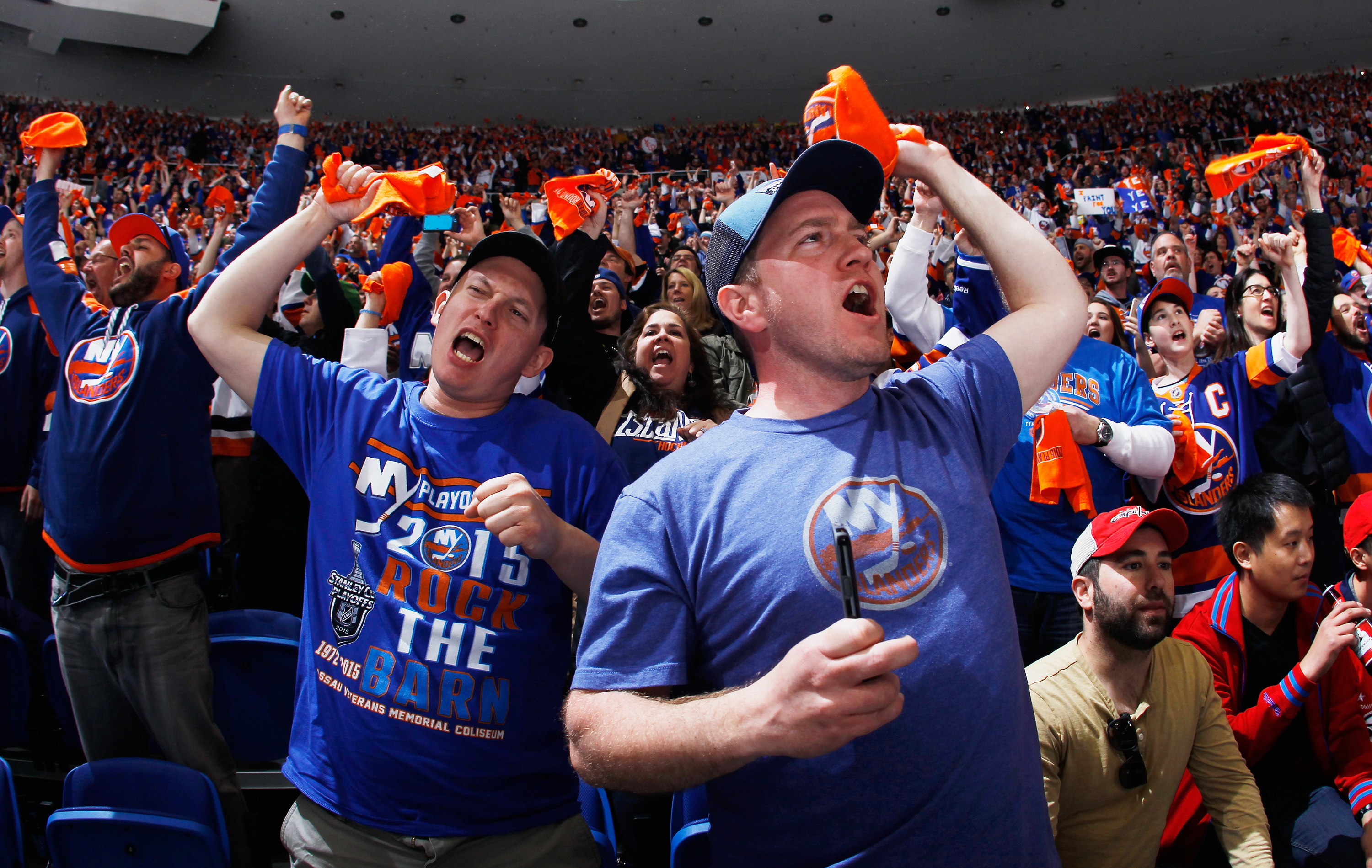 UNIONDALE, NY - APRIL 19:  Fans enjoy the atmosphere during the game between the New York Islanders and the Washington Capitals in Game Three of the Eastern Conference Quarterfinals during the 2015 NHL Stanley Cup Playoffs at the Nassau Veterans Memorial Coliseum on April 19, 2015 in Uniondale, New York.  (Photo by Bruce Bennett/Getty Images)