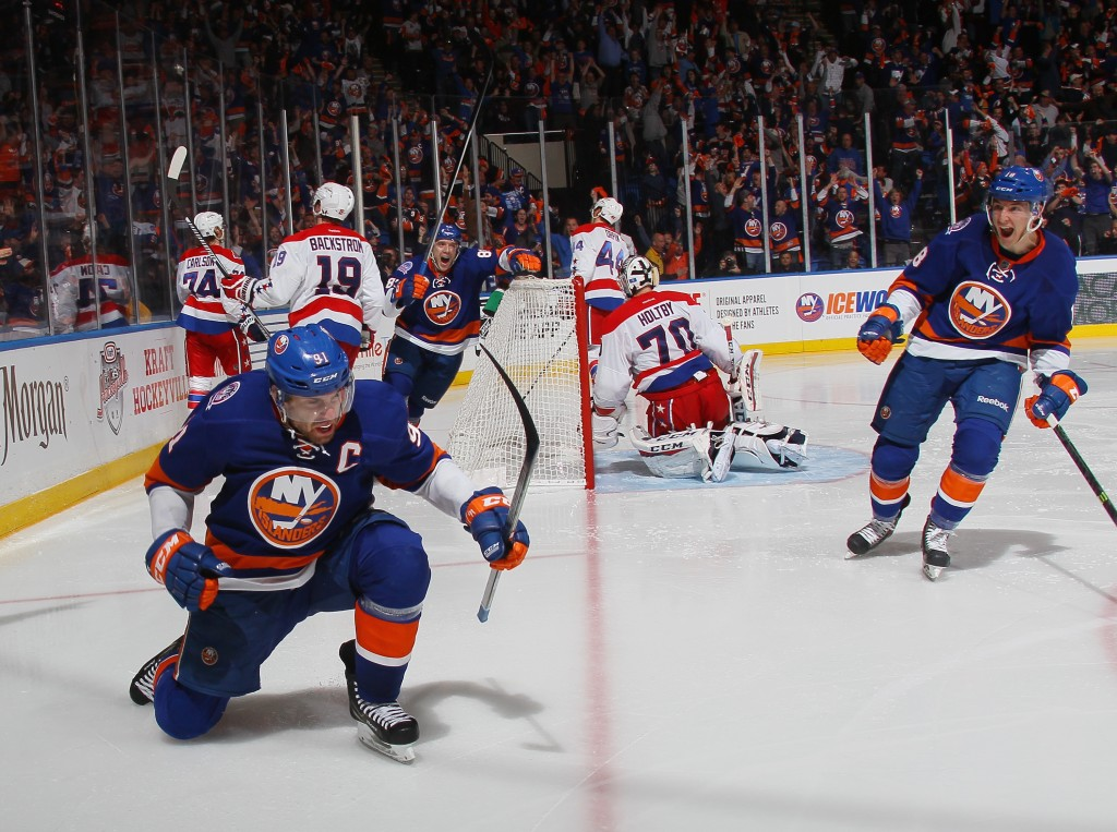 UNIONDALE, NY - APRIL 19: John Tavares #91 of the New York Islanders celebrates his game winning goal at 15 seconds of the overtime against the Washington Capitals in Game Three of the Eastern Conference Quarterfinals during the 2015 NHL Stanley Cup Playoffs at the Nassau Veterans Memorial Coliseum on April 19, 2015 in Uniondale, New York. The Islanders defeated the Capitals 2-1 in overtime. (Photo by Bruce Bennett/Getty Images)