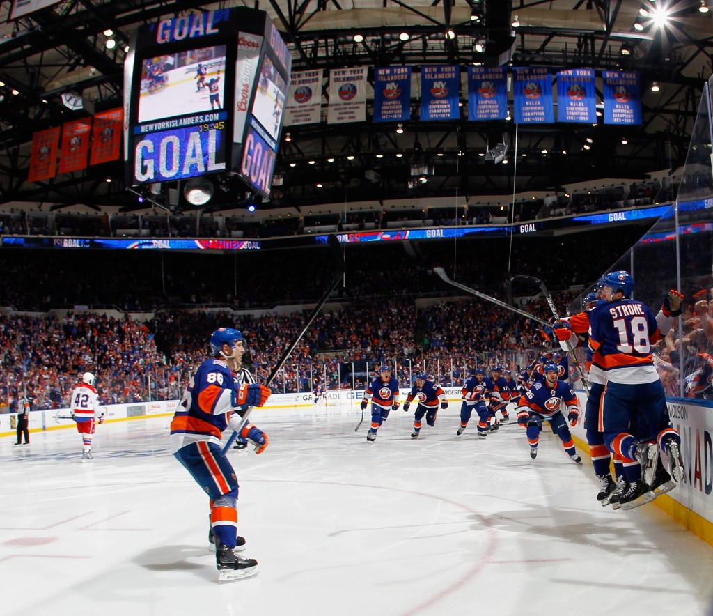 UNIONDALE, NY - APRIL 19:  New York Islanders celebrate a 2-1 overtime victory against the Washington Capitals in Game Three of the Eastern Conference Quarterfinals during the 2015 NHL Stanley Cup Playoffs at the Nassau Veterans Memorial Coliseum on April 19, 2015 in Uniondale, New York.  (Photo by Bruce Bennett/Getty Images)