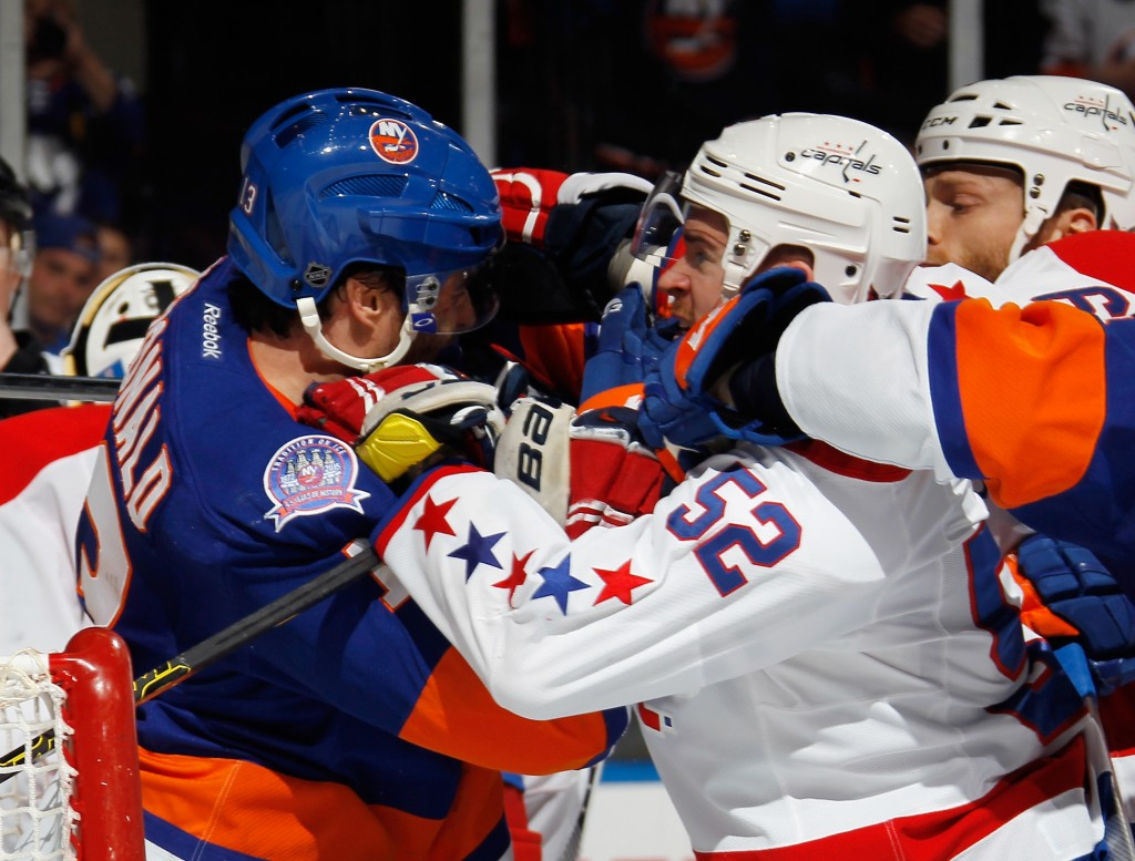 UNIONDALE, NY - APRIL 25: Colin McDonald #13 of the New York Islanders and Mike Green #52 of the Washington Capitals get into a scuffle during the second period in Game Six of the Eastern Conference Quarterfinals during the 2015 NHL Stanley Cup Playoffs at the Nassau Veterans Memorial Coliseum on April 25, 2015 in Uniondale, New York.  (Photo by Bruce Bennett/Getty Images)