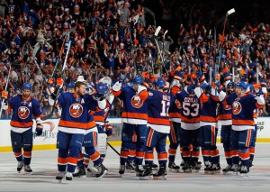 UNIONDALE, NY - APRIL 25: The New York Islanders celebrate their 3-1 victory over the Washington Capitals in Game Six of the Eastern Conference Quarterfinals during the 2015 NHL Stanley Cup Playoffs at the Nassau Veterans Memorial Coliseum on April 25, 2015 in Uniondale, New York.  (Photo by Bruce Bennett/Getty Images)